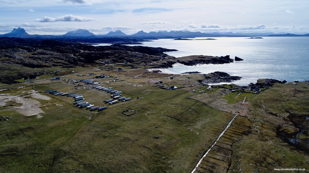 overhead view of Torran Grianach and caravan park looking south-west to sea and mountains